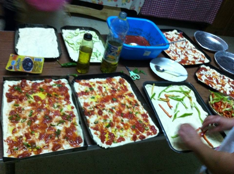 Italians making pizza